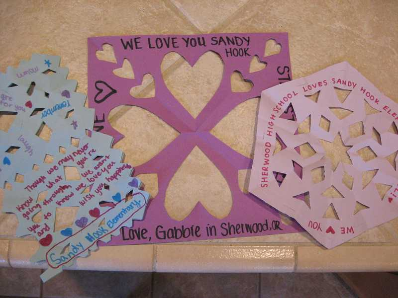 by: RAY PITZ - Here are several of the snowflakes containing personal messages for the students at Sandy Hook Elementary School, showing support from students at Sherwood High School.