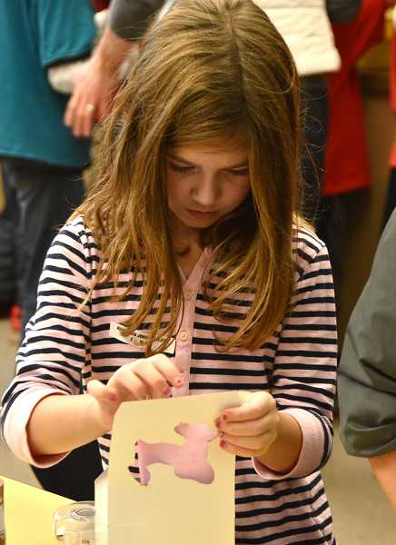 by: TIDINGS PHOTOS: VERN UYETAKE - Second-grader Makena Big John-Miller decorated a gift box.