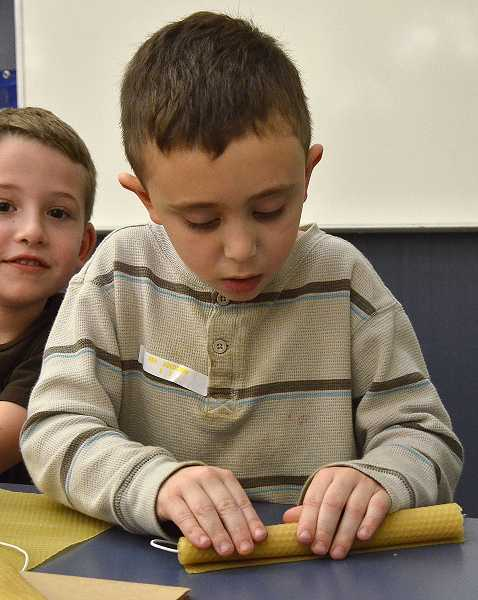 by: TIDINGS PHOTOS: VERN UYETAKE - Second-grader Ben Goldstein made candles for a gift.