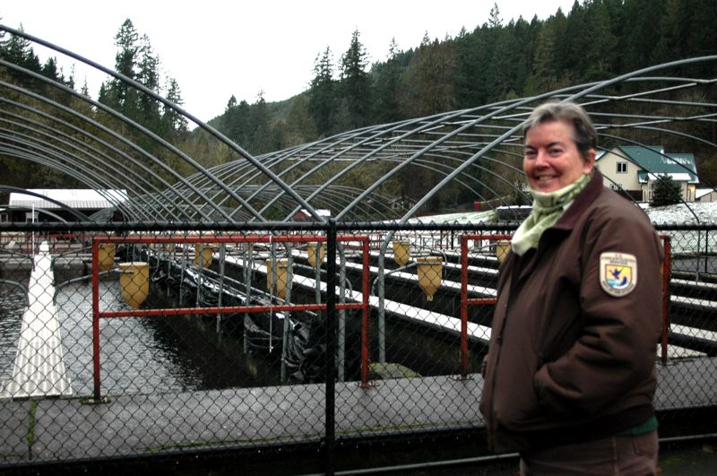 by: NEWS PHOTO: SCOTT JORGENSEN - Hatchery manager Caroline Peterschmidt shows off some of the facilitys features.