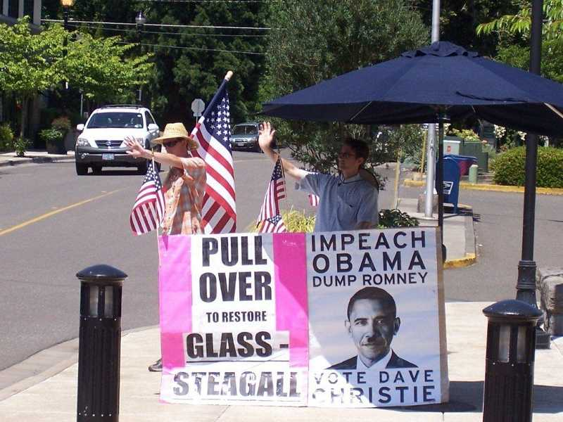 by: TOM NEFF - Two men created a sight along Highway 43 in West Linn on July 13 with their push to support Dave Christie, who was running for Congress.
