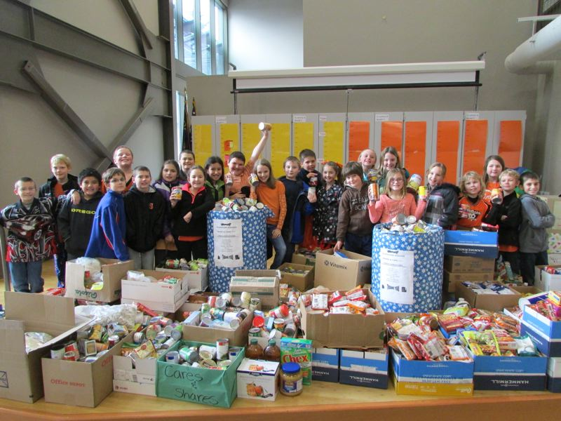 by: SPOTLIGHT PHOTO: KATIE WILSON - Class gathers most food items at Otto Petersen Elementary in Scappoose.