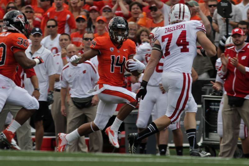 by: TRIBUNE PHOTO: CHRISTOPHER ONSTOTT - Oregon State's Jordan Poyer heads up the sidelines against Wisconsin.