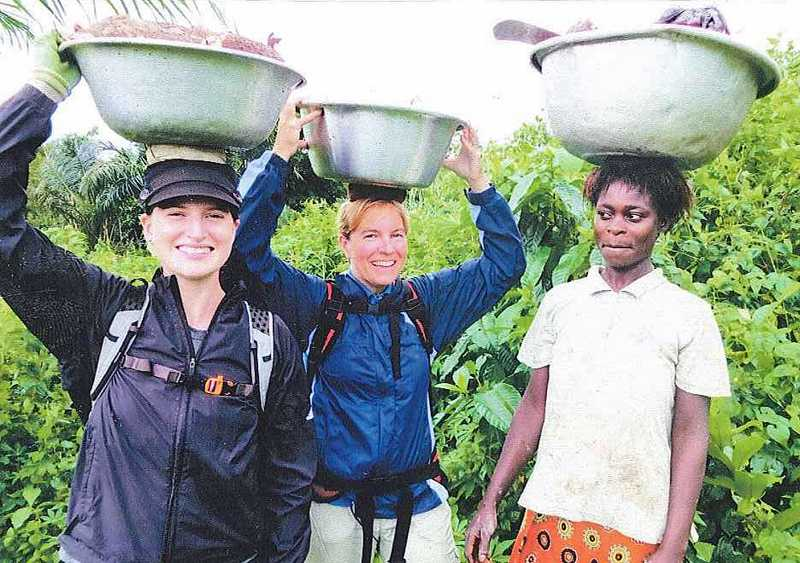 SUBMITTED PHOTO: Alyssa and Marlynn Rust helped Eya harvest cassova roots in the Dwenoose village at Cape Coast, Ghana.