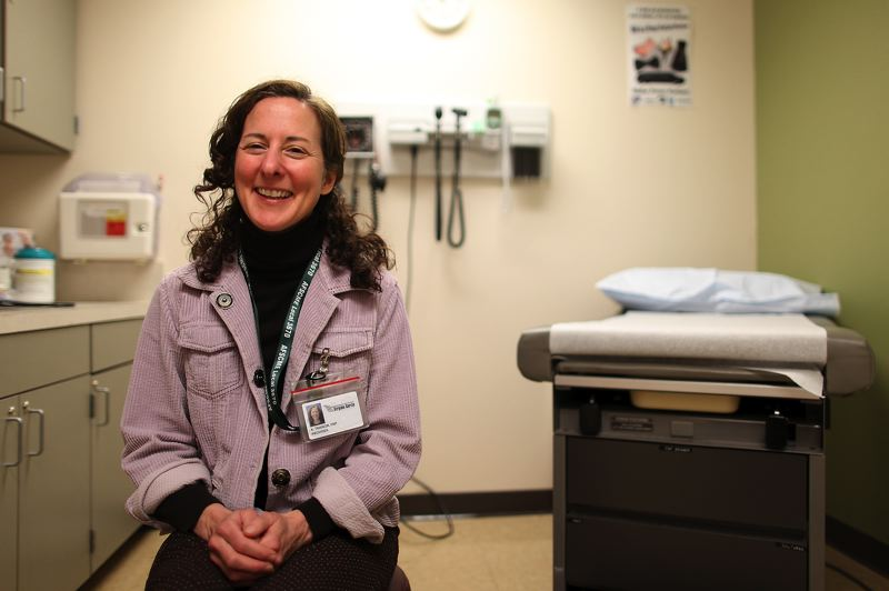 by: TIMES FILE PHOTO: JAIME VALDEZ - Nurse Practitioner Anne Trainor waits for patients at the school-based health center at Tigard High in 2011. The district received a $500,000 grant to build a second clinic at Tualatin High School in 2015.