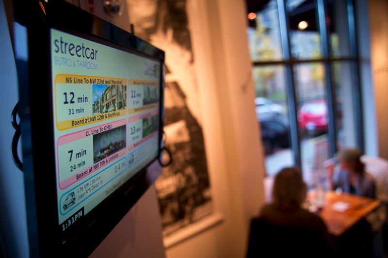 by: TRIBUNE PHOTO: CHRISTOPHER ONSTOTT - Customers in a rush at the Pearl District's Streetcar Bistro & Taproom know precisely when they have to dash out the door, thanks to Chris Smith's latest invention. The device tells when each transport option will arrive at a location.