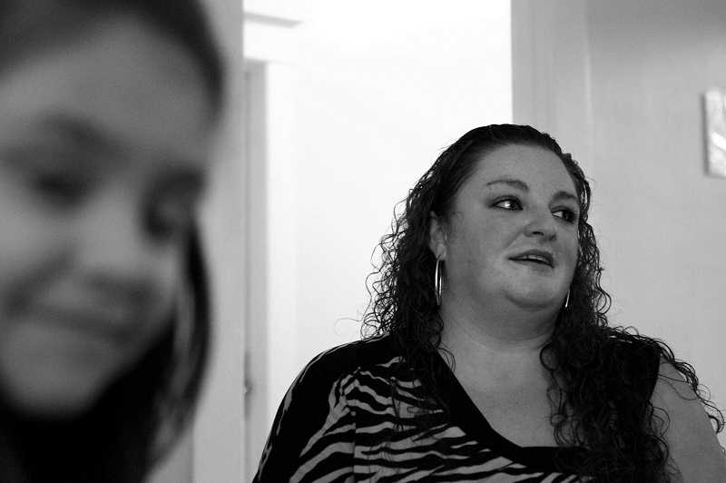 by: THE TIMES: JAIME VALDEZ - Amber Dement lives at Community Action shelter in Hillsboro and says that the staff's flexibility has allowed her to start getting back on her feet. Foreground: Dement's daughter, Mariela, 7.