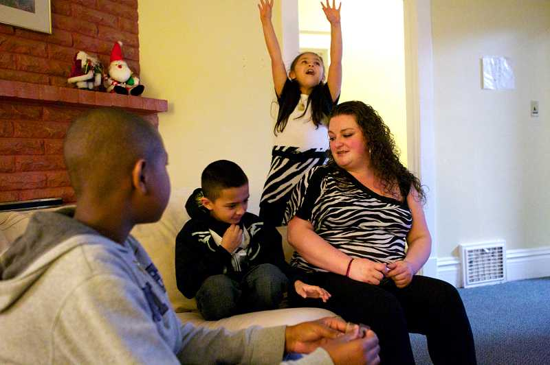 by: THE TIMES: JAIME VALDEZ - Amber Dement enjoys the clean facilities at Community Action shelter in Hillsboro. Shown here: Dement's son Miguel, 8, and daughter, Mariela, 7. Foreground: Family friend Daiqwan, whose family is also staying at the shelter.