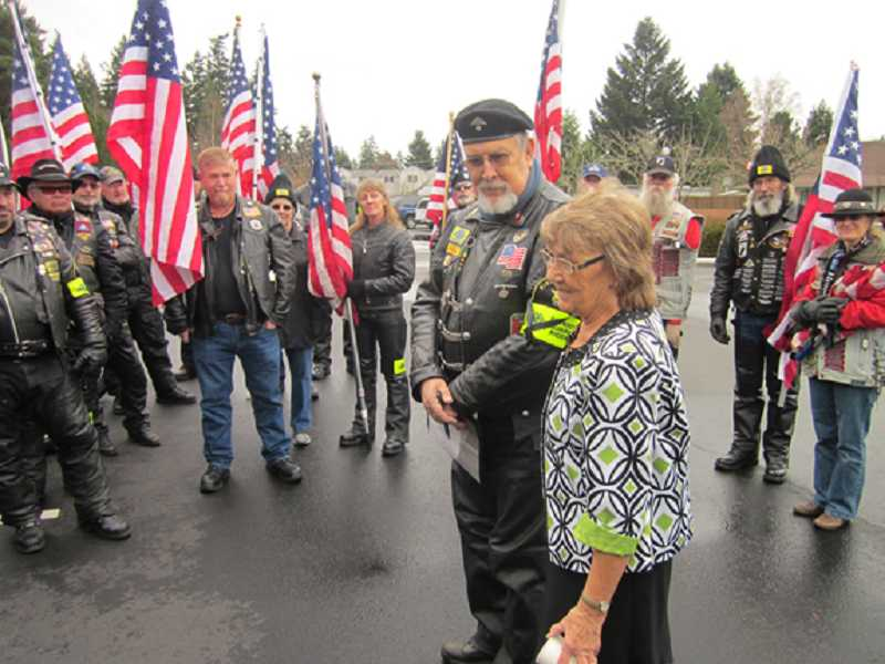 by: BARBARA SHERMAN - SHOW OF RESPECT - Before a memorial service for Korean War veteran Keith DeLashmutt in the Royal Villas Clubhouse, his longtime companion Joyce Clark, standing next to team captain Jerry Manning, thanks members of the Oregon Patriot Guard Riders for coming.