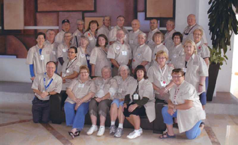 by: COURTESY OF RUPERT FIXOTT - HOLA! - All the Lions club members who traveled on a humanitarian trip to Mexico in November to provide eyeglasses gather for a group photo.