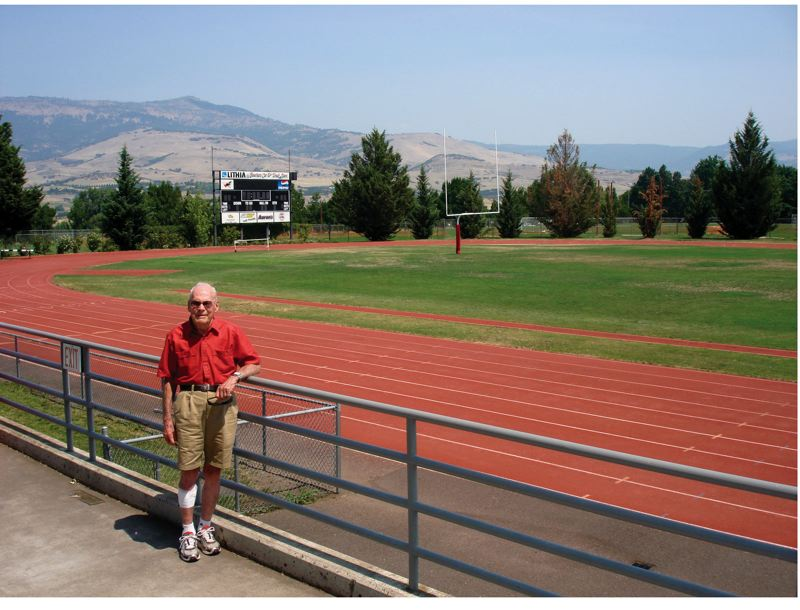 by: CANDY PUTERBAUGH - Bulkley at the Southern Oregon University track field before it was dedicated to him and renamed the Dan Bulkley Track last November.
