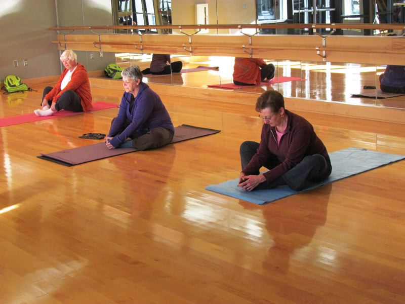 by: KAY-LANI MUNRO/PORTLAND PARKS & RECREATION - A senior yoga class at the Charles Jordan Community Center. Portland Parks & Recreations senior recreation program offers yoga this winter at the Charles Jordan center and at the Mt. Scott Community Center and First Congregational Church.