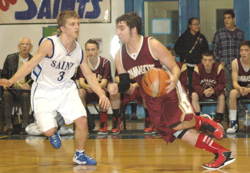 by: THE OUTLOOK: PARKER LEE - Damascus Christian guard Eddie Zopf, right, drives past an opponent during the Eagles 48-37 win in Valley 10 play last Friday. Zopf led the team with 18 points.