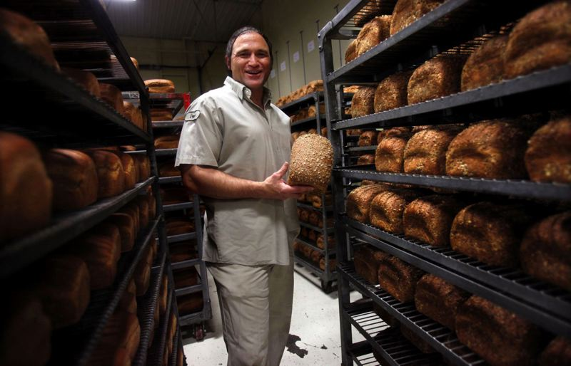 by: PAMPLIN MEDIA FILE PHOTO: JONATHAN HOUSE - Dave Dahl, founder of Dave's Killer Bread in Milwaukie, is selling part of the company to a New York firm that will help it expand sales across the nation. The company's 'Breadquarters' is going to stay in Milwaukie, Dave said.