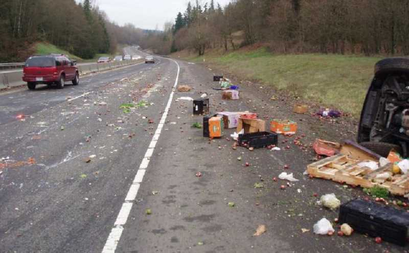 by: OREGON STATE POLICE - A lane of traffic on Highway 213 was closed for two hours after a trailer dumped, spilling produce across the road.
