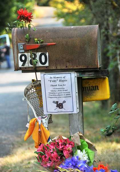 In September, a neighbor set up this memorial at the mailbox of Lake Oswego's Fritz Hayes who was brutally murdered at his home after returning from a morning walk.