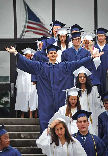 Lake Oswego High School senior Zach Walen expresses his joy as he marches with his classmate to the graduation ceremony.