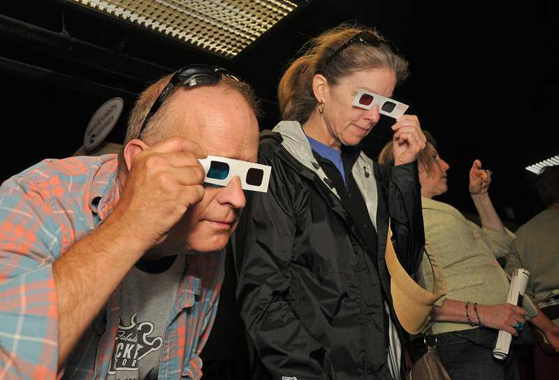 Robert Parrish and Kitta Frost check out a stereoscopic photo display at the annual Lake Oswego Festival of the Arts in June.