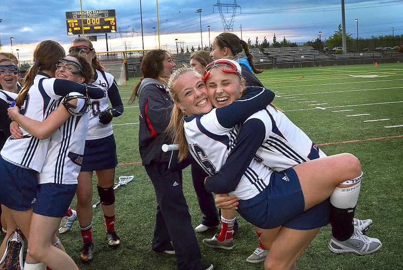 Lake Oswego High School's Lily Newman, left, and Madeline Reece, right, celebrate after the Laker girls claim their second consecutive state lacrosse title back in May.