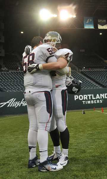 Lake Oswego High School's Reid Penney, left, and Mitch Lomax console each other after the Lakers failed in their attempt to repeat as state champions earlier this month.