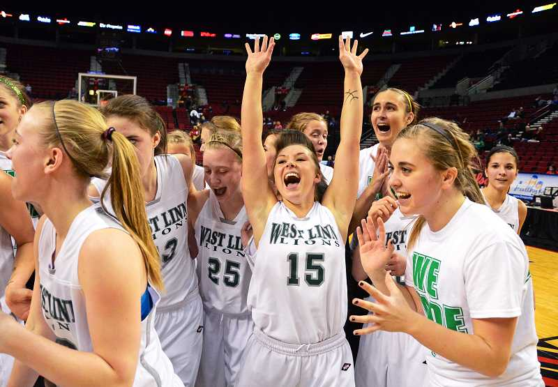 The West Linn girls basketball team celebrates after rallying to beat No. 1 ranked Oregon City in the state tournament back in March.