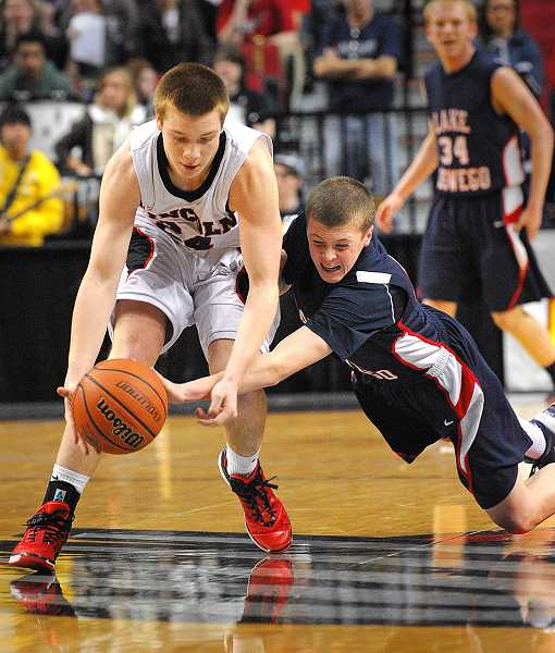 Lake Oswego's Jason Luhnow goes for a steal in a state tournament game against Lincoln in March.