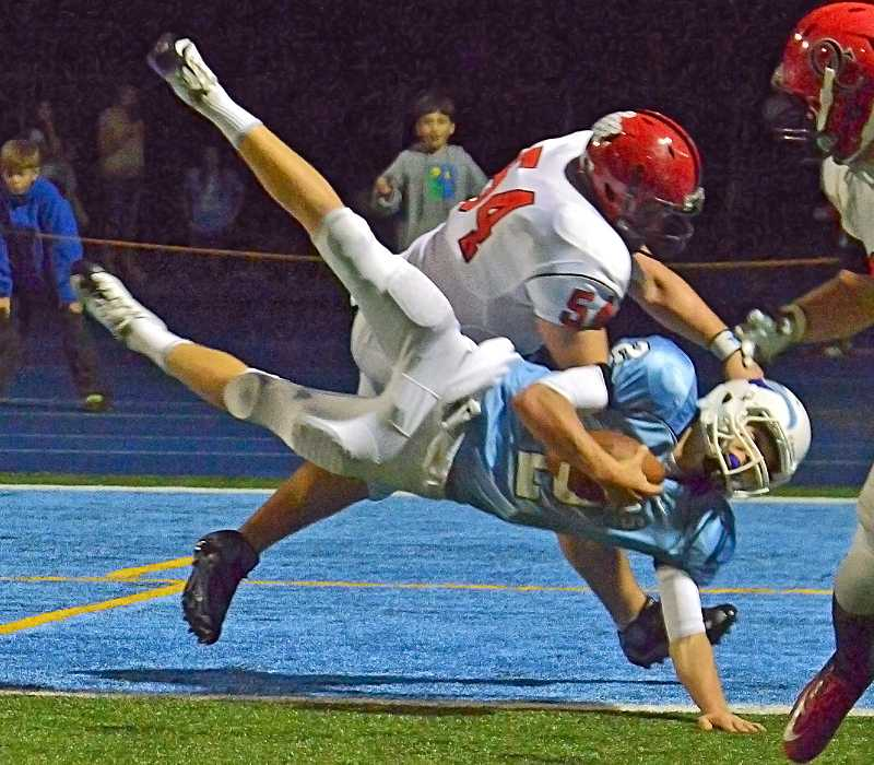 Lakeridge High School quarterback Eric Dungey lunges for the goal line in the Pacer's game against Oregon City in September. Dungey came up short as did the Pacers as they lost to the Pioneers 59-21.
