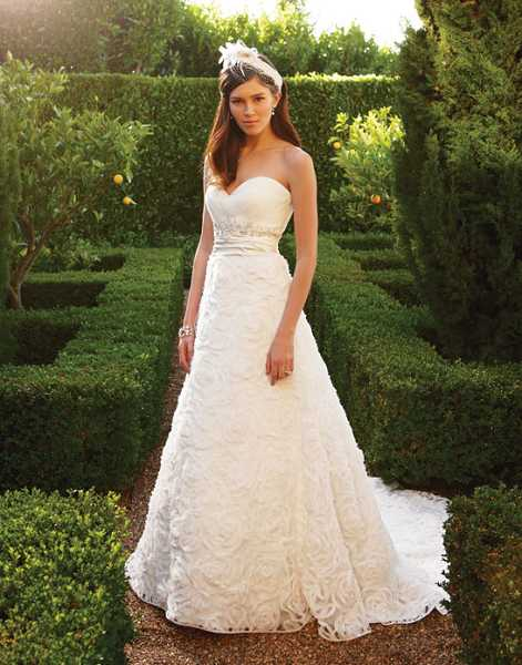 by: SUBMITTED PHOTO - View gowns like the Casablanca & CB Bridal Couture gown shown here at Anna's Bridal Boutique in Lake Oswego.