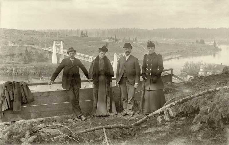by: OLD OREGON PHOTOS - Two couples stand along the bluffs overlooking early West Linn.