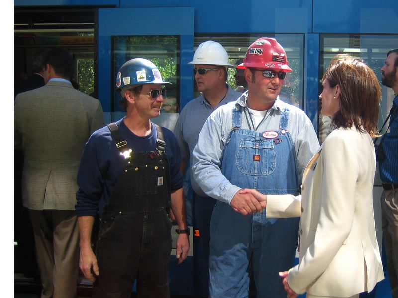 by: ANN LININGER FOR COMMISSIONER - Ann Lininger, in a photo on her campaign website for Clackamas County commissioner, meets with Oregon Iron Woks staff in 2009 who built the first American-made streetcar in 60 years.