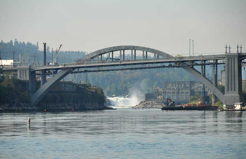 by: VERN UYETAKE - After being closed for 22 months, the arch bridge between West Linn and Oregon City reopened to traffic in October.