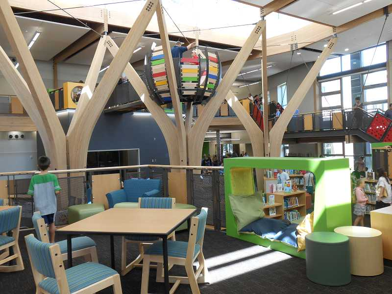 by: TIDINGS FILE PHOTO: JORDY BYRD - Trillium Creek Primary School opened in 2012. The library features an indoor tree fort and slide.