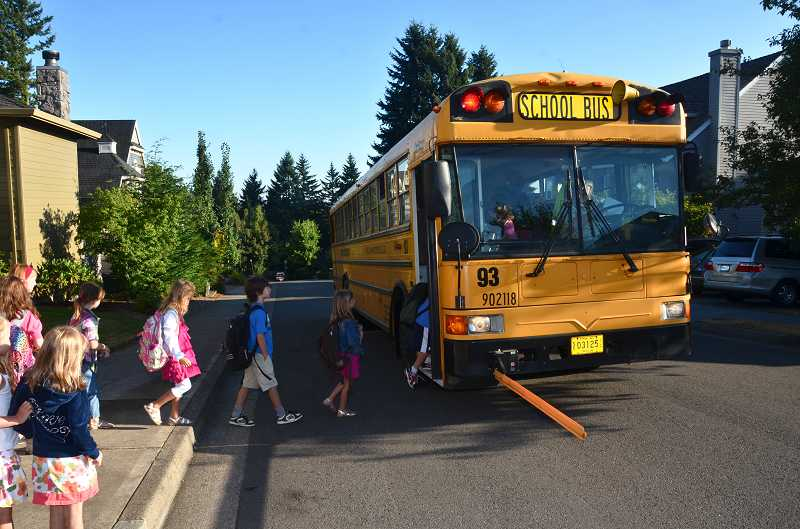 by: TIDINGS FILE PHOTO: VERN UYETAKE - First Student and West Linn-Wilsonville School District employees reviewed safety procedures after a 5-year-old was left alone in the rain for an hour in October.