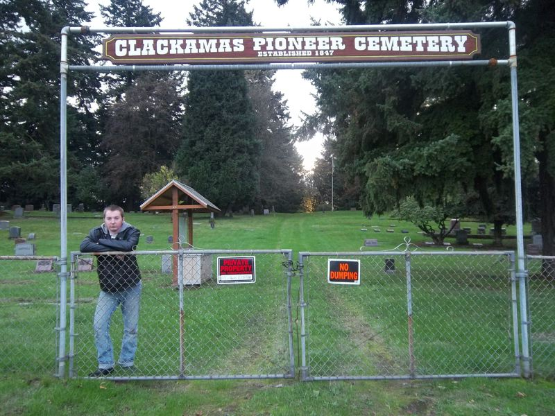 by: SUBMITTED PHOTO -  Fifteen-year-old Bryan Bufton stands proudly in front of a new sign he created for the Clackamas Pioneer Cemetery.