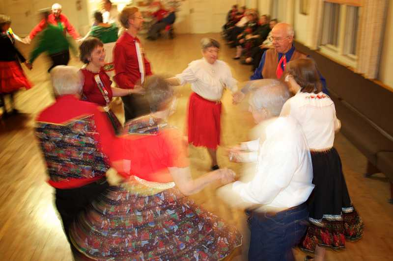 by: TIMES PHOTO: JAIME VALDEZ - Tri Squares dancers circle left as they dance the night away at the Tigard Grange. The Tri Squares are offering free dance lessons this month at the Tigard Grange.