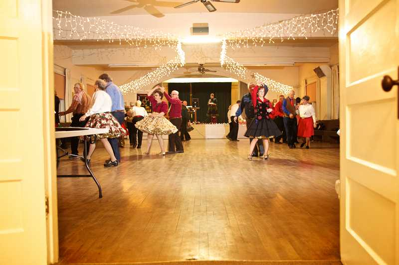 by: TIMES PHOTO: JAIME VALDEZ - The Tigard Grange transforms into a den of swirling couples as members of the Tri Squares get down to some square dancing. The group meets for dances twice a month.