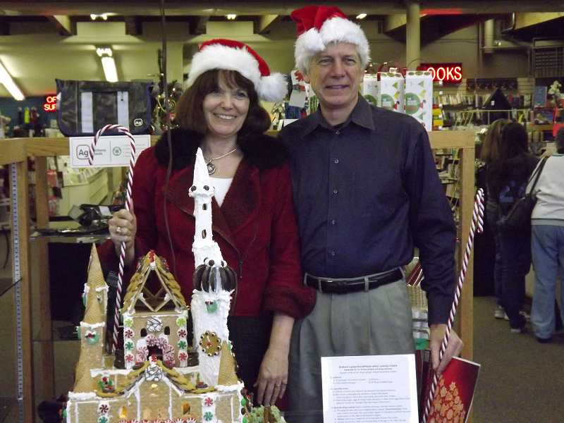 by: JAMIE INGLIS - Terri and Paul Graham stand by the gingerbread castle that is making them famous. Their creation again was voted tops in Lake Oswego.