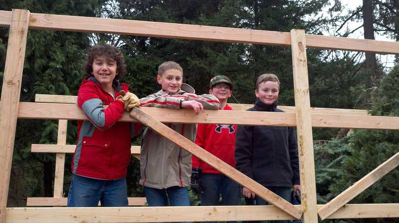 by: SUBMITTED - Scouts from Boy Scout Troop 230 will be recycling Christmas trees this weekend at Parsons Farm lot, located at Kruse Way and Carman Drive. Pictured from left are Duncan Nodarse, Mason Mann, Bun Suhler and Sammy Sullivan.