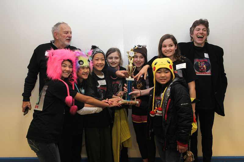 by: SUBMITTED PHOTO - The Xploding Robowheels took first place at the LEGO robotics regional competition held Dec. 8 at Catlin Gabel. Pictured are, from left, Larissa Chan of Touchstone Elementary, Sera Lew of Stafford Primary School, Ryan Lew of Lake Oswego Junior High, Alex Morrow, Katie Oppenheimer and Natalie Peterman, all students at Touchstone, and Kira Takara of Lake Oswego Junior High. The team is coached by Dale Kresge, second row on left, and Lillian Oppenheimer, on right.