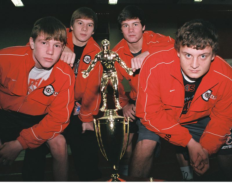 by: JOHN DENNY -  Trophy Hunters  Returning state placers (from left) Devin Poppen, Kyle Sether, Parker Folliard and Michael McCoy believe the Oregon City Pioneers have the horses to capture a trophy at state this season.