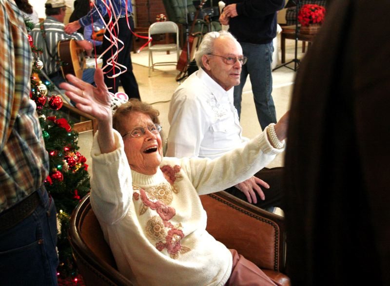 by: OUTLOOK PHOTO: JIM CLARK - Marie Diercks, seated with her boyfriend, Dwight Hale, greets a friend who came to help celebrate her 100th birthday.