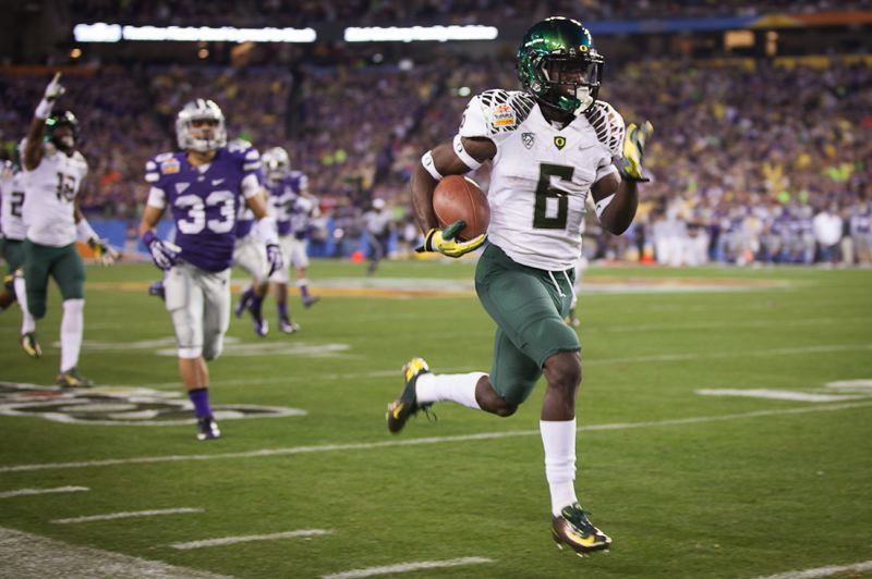 by: TRIBUNE PHOTO: MEG WILLIAMS - Oregon's De'Anthony Thomas scores with the opening kickoff in Thursday's Fiesta Bowl at Glendale, Ariz.