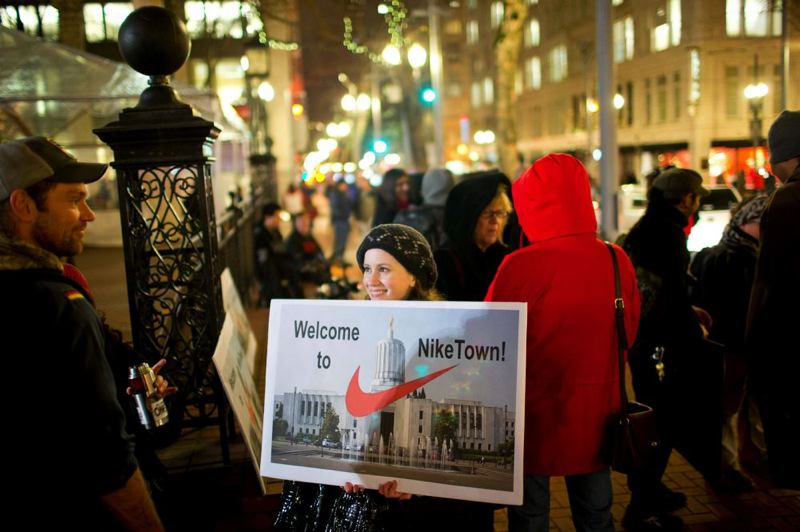 by: TRIBUNE PHOTO: CHRISTOPHER ONSTOTT - Not everyone agrees with the discussions between Nike, the state and Washington County to maintain the apparel company's presence here via financial incentives. Protesters are questioning whether Nike tax breaks are merited while teachers and students are suffering from deep budget cuts as a result of plummeting school district operating revenues.