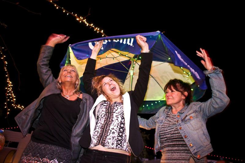 by: TRIBUNE PHOTO: JAIME VALDEZ - Tammi Wilson of Portland (left) parties among Oregon football fans at Dos Gringos in Scottsdale, Ariz., on New Years Eve and before the Fiesta Bowl. Her friends, Keira Macnaughton (middle) and Vicki Macnaughton are from Canada.