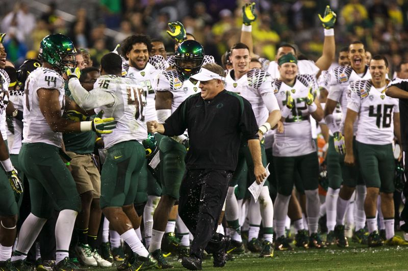 by: TRIBUNE PHOTO: JAIME VALDEZ - Oregon coach Chip Kelly gets drenched by his players at the end of the Ducks' 35-17 Fiesta Bowl win over Kansas State.