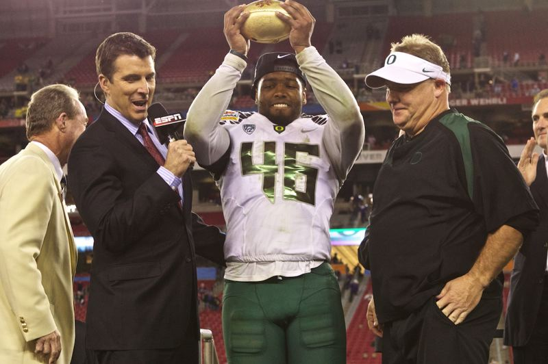 by: TRIBUNE PHOTO: JAIME VALDEZ - Coach Chip Kelly shares the stage as Oregon linebacker Michael Clay is named defensive MVP of the Fiesta Bowl