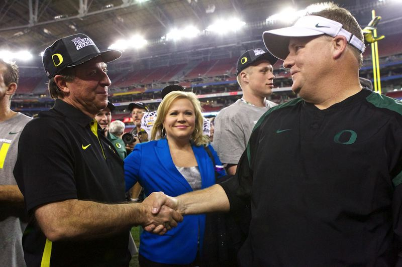 by: TRIBUNE PHOTO: JAIME VALDEZ - Oregon coach Chip Kelly and defensive coordinator Nick Aliotti shake hands after the Ducks cap a 12-1 season with their 35-17 win over Kansas State in the Fiesta Bowl.