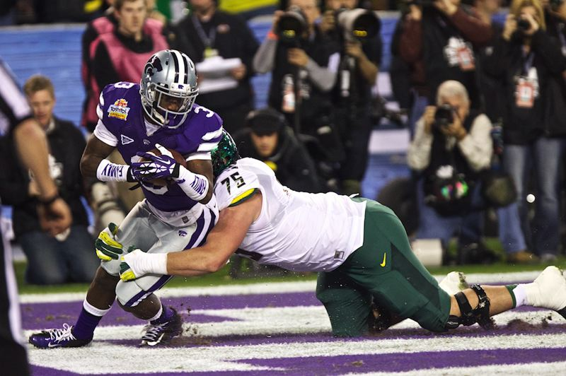 by: TRIBUNE PHOTO: JAIME VALDEZ - Oregon's Jake Fisher tackles Kansas State's Allen Chapman for a one-point safety after the Wildcats blocked the Ducks' extra-point try.