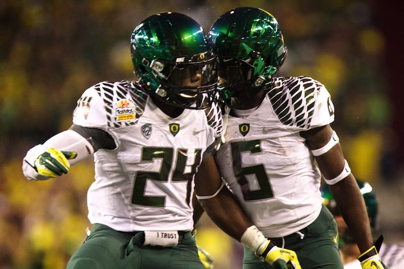 by: TRIBUNE PHOTO: JAIME VALDEZ - Oregon Ducks running back Kenjon Barner (left) celebrates with teammate De'Anthony Thomas after Barner scored a touchdown in the first half against Kansas State.
