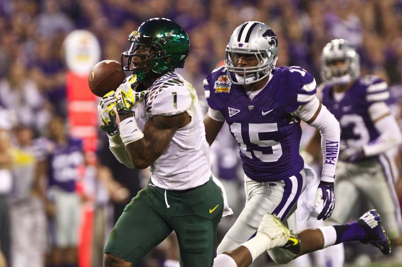 by: TRIBUNE PHOTO: JAIME VALDEZ - Ducks wide receiver Josh Huff bobbles the ball after being interfered with by Kansas State defensive back Randall Evans in the Fiesta Bowl.